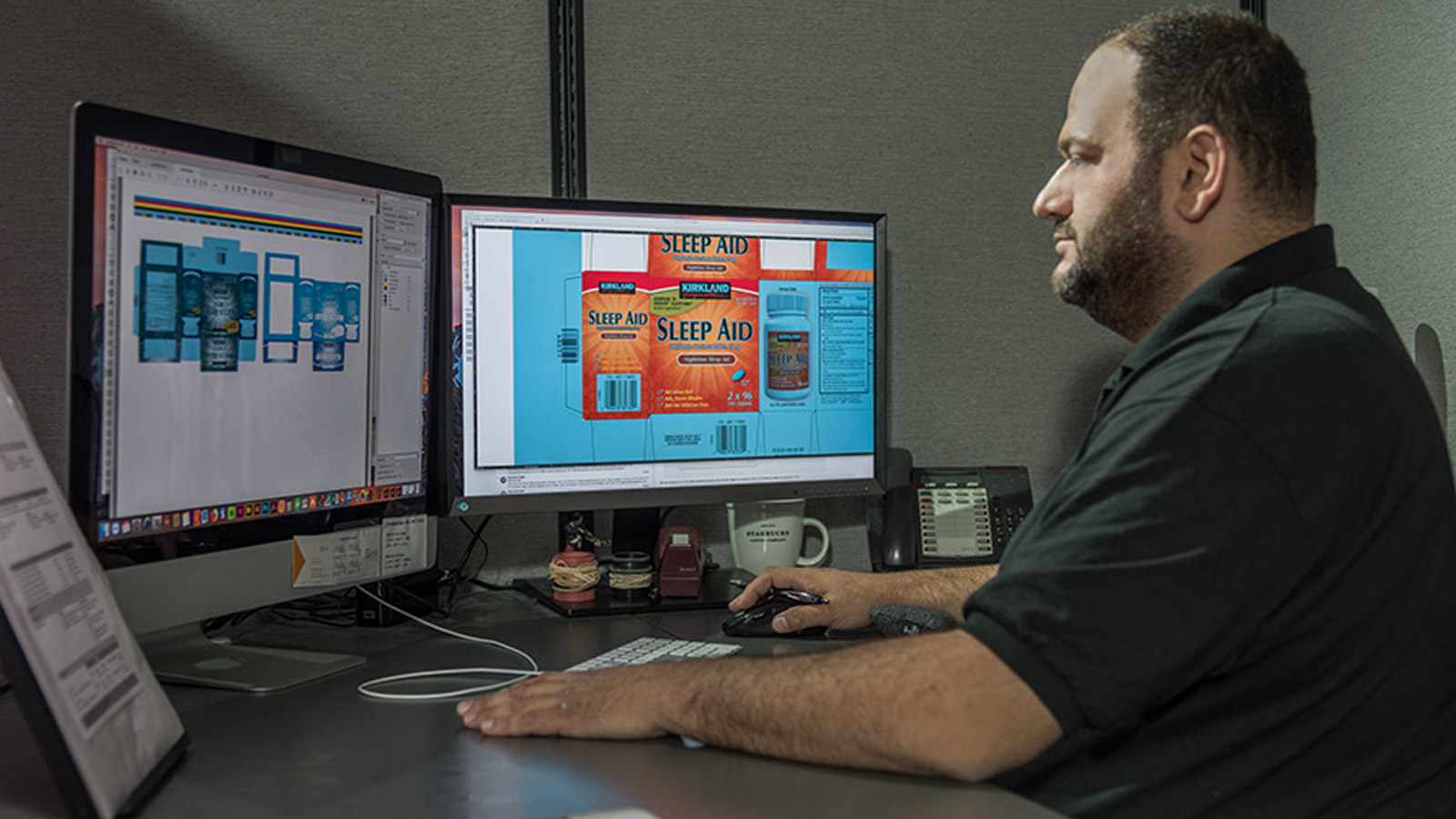 designer creating pharmaceutical labels on a computer